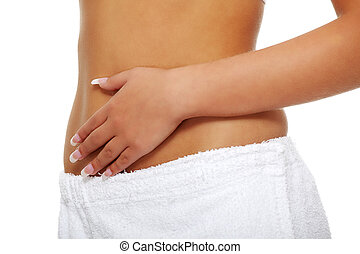 Woman touching her belly - Young slim healthy woman with...