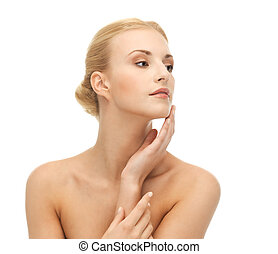 woman touching her face skin