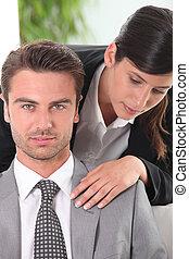 Woman touching her husband's shoulder