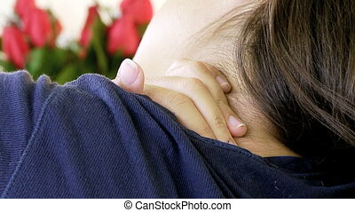 Woman touching sore neck