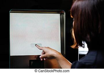 Woman touching the screen