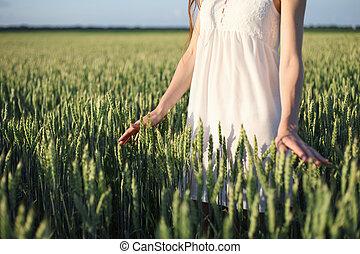 woman touching wheat ear