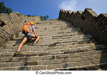 woman tourist climbing to the top of greatwall enjoy the...