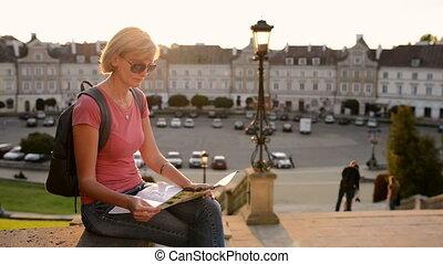 Woman tourist enjoying a view of a old city square - Woman...