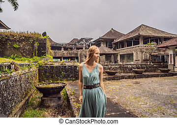 Woman tourist in abandoned and mysterious hotel in Bedugul. ...