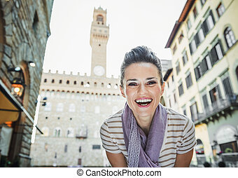Woman tourist in the front of Palazzo Vecchio in Florence, Italy