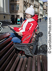 woman tourist is looking at a city map