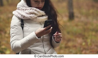 woman tourist is looking for an address with a GPS navigator on a smartphone