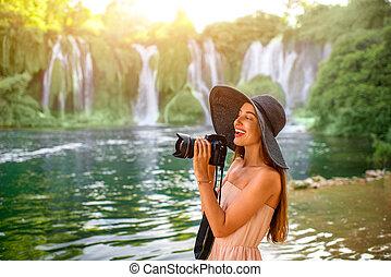 Woman tourist near Kravica waterfall - Young woman tourist...