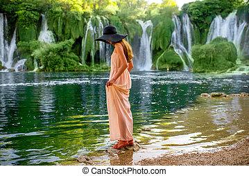 Woman tourist near Kravica waterfall