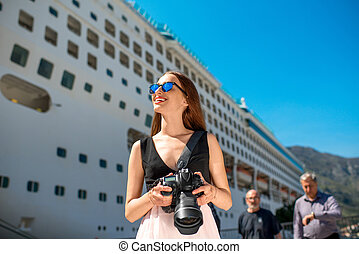Woman tourist near the big cruise liner - Young woman...