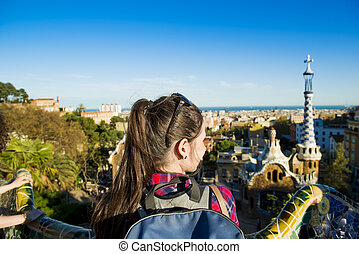 Woman tourist - Rear view of young female tourist looking at...