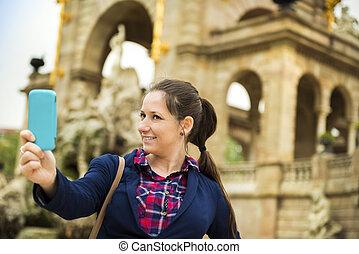 Woman tourist - Pretty young female tourist taking selfie in...