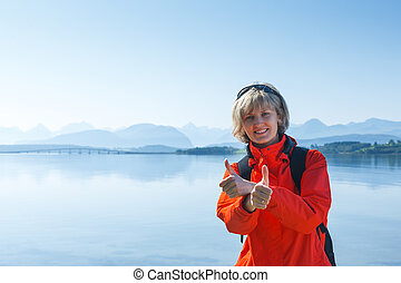 Woman tourist showing thumbs up