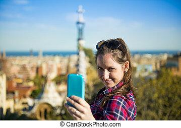 Woman tourist - Pretty young female tourist takes selfie in...