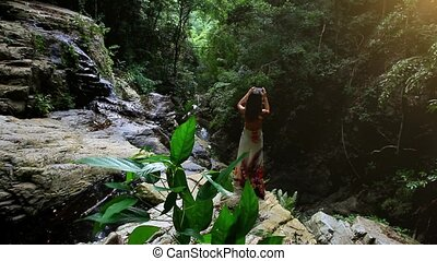 woman tourist taking photo with smart phone in jungle on waterfall Koh Samui. Thailand. HD. 1920x1080