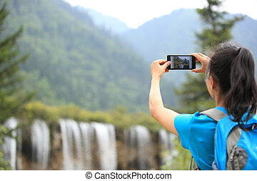 woman tourist taking photo