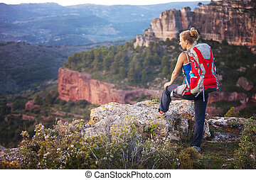 Woman tourist watching valley view