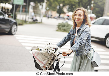 Woman tours the city on a bicycle