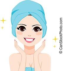 Woman Towel Bath - Woman with hair wrapped in blue bath...