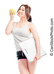 woman tracking the her figure shot on a white background