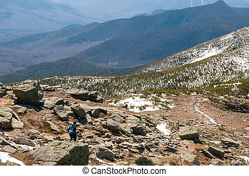 Woman trail running in the mountains