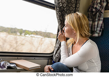 Woman train traveling looking out the window