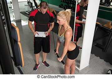 Woman Train Triceps With Personal Trainer
