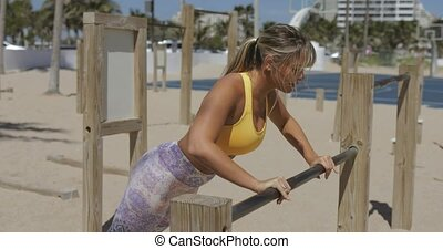 Woman training on beach gym