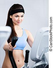 Woman training on gym training in gym