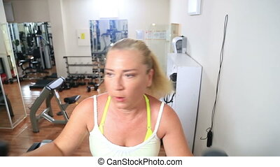 Woman Training On Steps In Gym