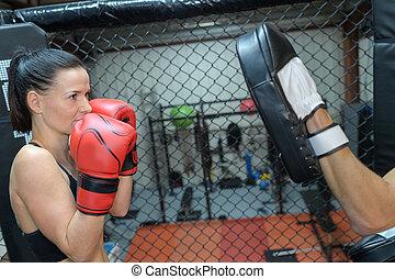 Woman training to box