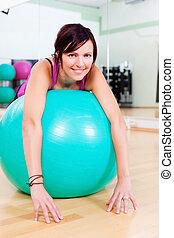 Woman training with a gymnastics ball