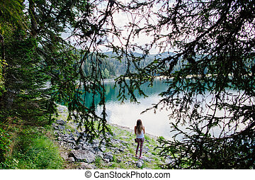 woman travel in beautiful lake and forest