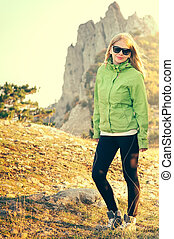 Woman Traveler hiking in Mountains with beautiful summer landscape on background mountaineering sport lifestyle concept