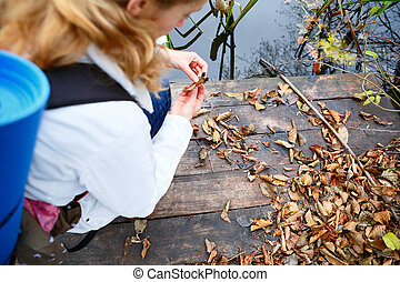 Woman traveler on a wooden platform in the autumn river