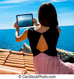 Woman traveler photographing sea scape - Young woman ...