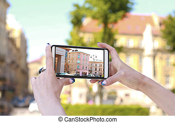 Woman traveler taking picture on the smartphone