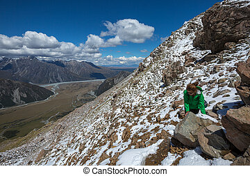 Woman Traveler with Backpack hiking in Mountains