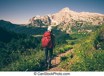 Woman Traveler with backpack hiking