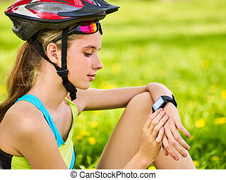 Woman traveling bicycle in summer park. Girl watch smart ...