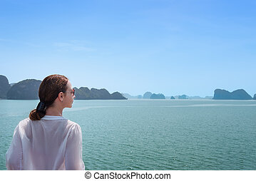 Woman traveling by boat among the islands