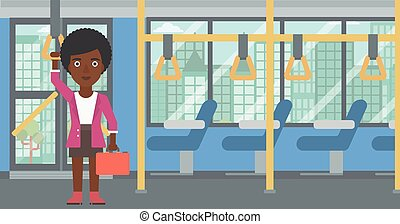 Woman traveling by public transport. - An african-american...