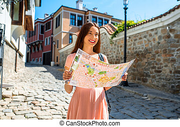Woman traveling in Plovdiv old city center - Young woman...