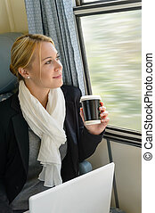 Woman traveling looking out the train window