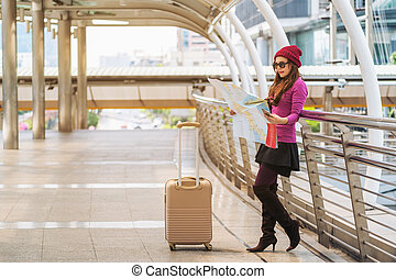 Woman traveller looking at travel map