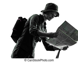 woman trekker trekking looking at map silhouette