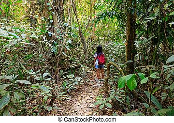 Woman trekking in Asian jungle