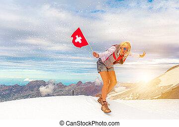 Woman trekking in the snow storm