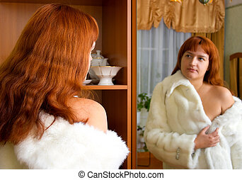 woman tries on a fur coat 2
